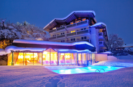 Exterior view of Hotel Berner by night in winter