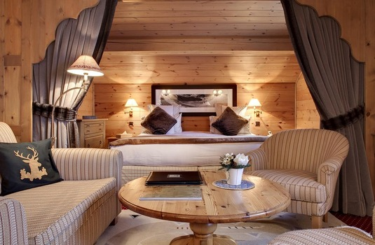 Ski Solutions Le Grand Coeur and Spa double bedroom with seating area