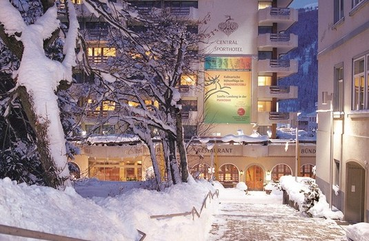 central sporthotel in Davos Exterior by night inwinter