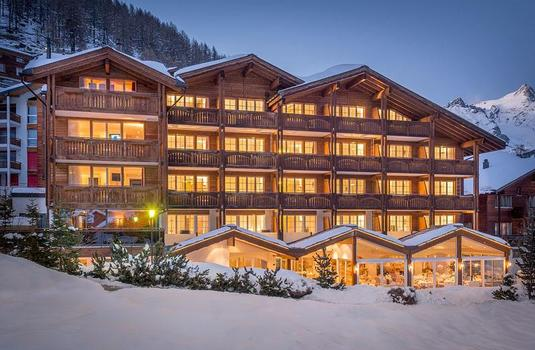 Resort carousel hotel schweizerhof exterior night saas fee