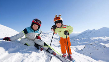 Kids skiing in the snow