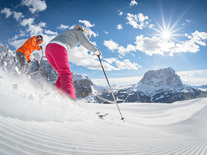 Two skiers skiing in South Tyrol Italy