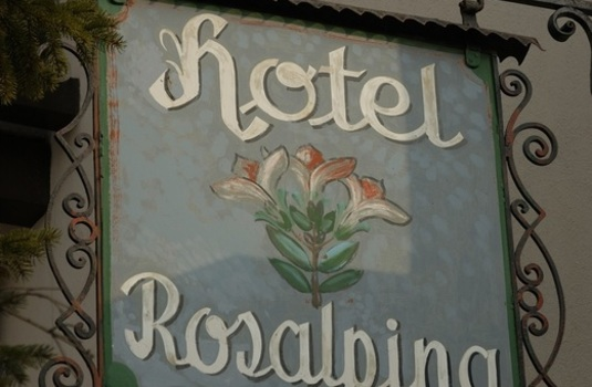 Resort carousel hotel rosa alpina sign