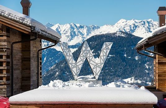 Resort carousel w verbier sign