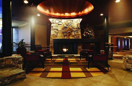 Resort carousel hilton whistler lobby fireplace