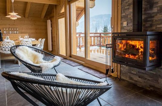 Resort carousel chalet olive  seats and log fire