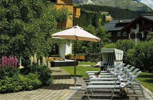Resort carousel hotel gotthard  garden with deckchairs