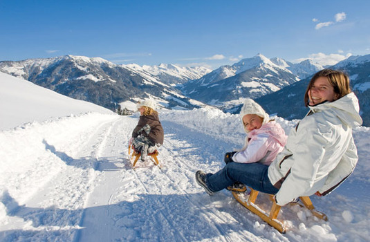 Kids sledging in Alpbach