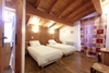 Chalet Caribou twin bedroom in the French ski resort of Courchevel
